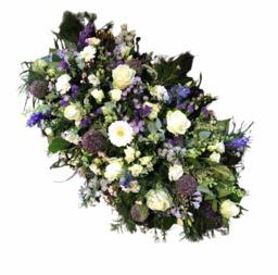 Rouwarrangement lang wit paars